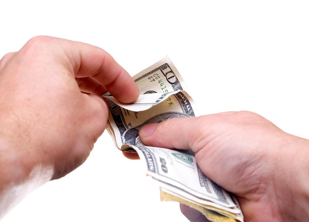 man counting money image georgia web development